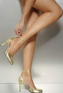 Woman - Wearing Gold Shoes